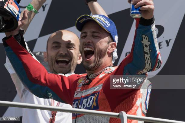 Andrea Dovizioso of Italy and Ducati Team celebrates the victory on the podium at the end of the MotoGP race during the MotoGp of Italy Race at...