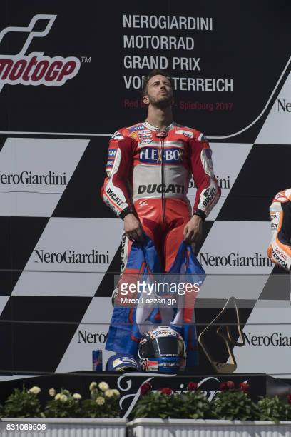 Andrea Dovizioso of Italy and Ducati Team celebrates the victory on the podium at the end of the MotoGP race during the MotoGp of Austria Race at Red...