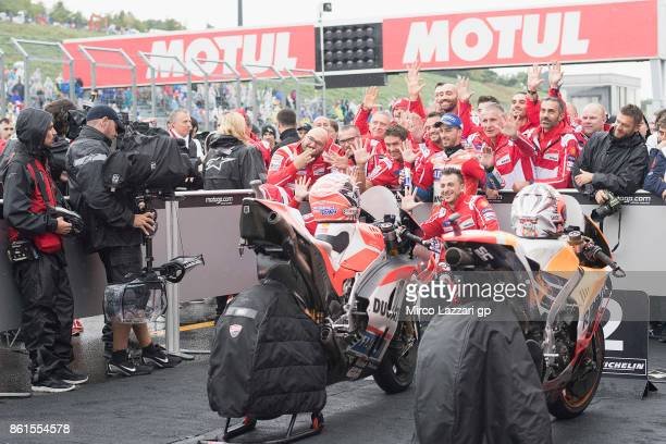Andrea Dovizioso of Italy and Ducati Team celebrates the victory under the podium at the end of the MotoGP race during the MotoGP of Japan Race at...