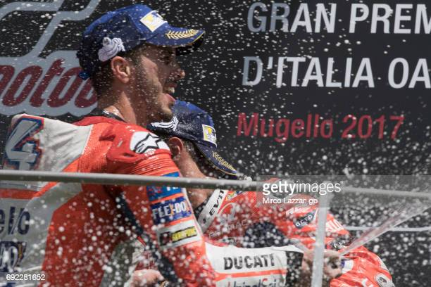 Andrea Dovizioso of Italy and Ducati Team celebrates the victory with champagne on the podium at the end of the MotoGP race during the MotoGp of...