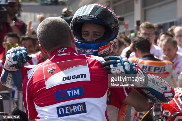 Andrea Dovizioso of Italy and Ducati Team celebrates the victory with team at the end of the MotoGP race during the MotoGp of Austria Race at Red...