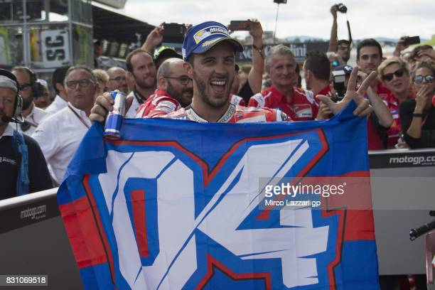 Andrea Dovizioso of Italy and Ducati Team celebrates the victory with the flag at the end of the MotoGP race during the MotoGp of Austria Race at Red...