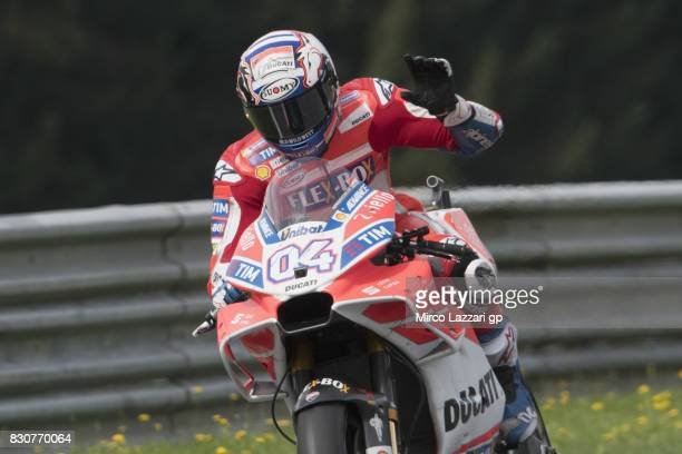 Andrea Dovizioso of Italy and Ducati Team greets the fans and heads down a straight during the MotoGp of Austria Qualifying at Red Bull Ring on...