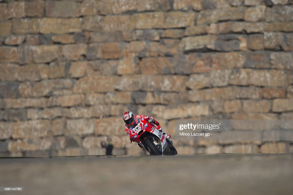 <a gi-track='captionPersonalityLinkClicked' href=/galleries/search?phrase=Andrea+Dovizioso&family=editorial&specificpeople=559970 ng-click='$event.stopPropagation()'>Andrea Dovizioso</a> of Italy and Ducati Team heads down a straight during the MotoGP of Spain - Free Practice at Motorland Aragon Circuit on September 26, 2014 in Alcaniz, Spain.