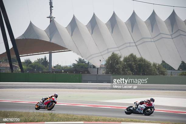 Andrea Dovizioso of Italy and Ducati Team leads Dani Pedrosa of Spain and Repsol Honda Team during the MotoGP Tests In Misano at Misano World Circuit...