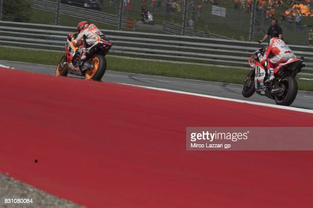 Andrea Dovizioso of Italy and Ducati Team leads Marc Marquez of Spain and Repsol Honda Team during the MotoGP race during the MotoGp of Austria Race...