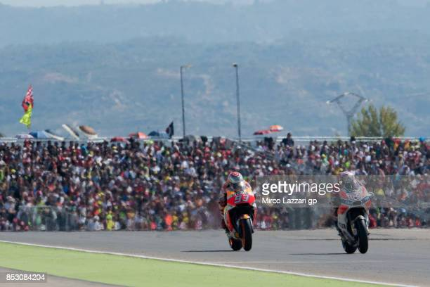 Andrea Dovizioso of Italy and Ducati Team leads Marc Marquez of Spain and Repsol Honda Team during the MotoGP race during the MotoGP of Aragon Race...