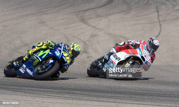 Andrea Dovizioso of Italy and Ducati Team leads Valentino Rossi of Italy and Movistar Yamaha MotoGP during the MotoGP race during the MotoGP of...