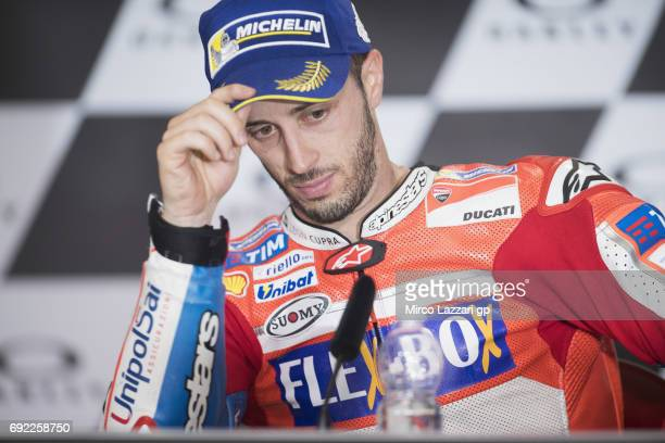 Andrea Dovizioso of Italy and Ducati Team looks on during the press conference at the end of the MotoGP race during the MotoGp of Italy Race at...