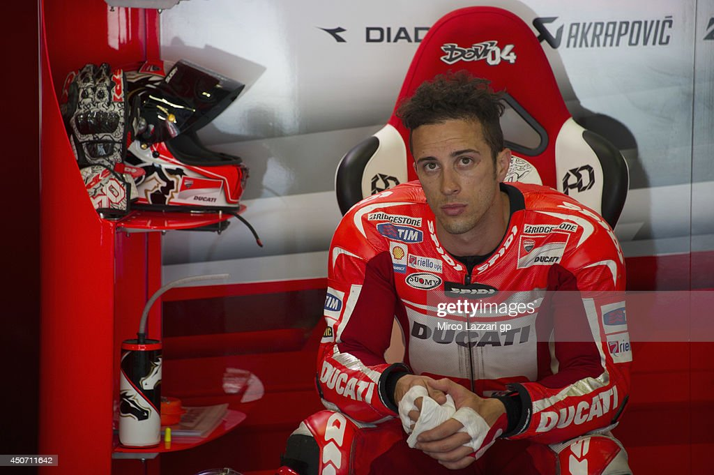 Andrea Dovizioso of Italy and Ducati Team looks on in box during the MotoGp Tests In Montmelo at Circuit de Catalunya on June 16, 2014 in Montmelo, Spain.