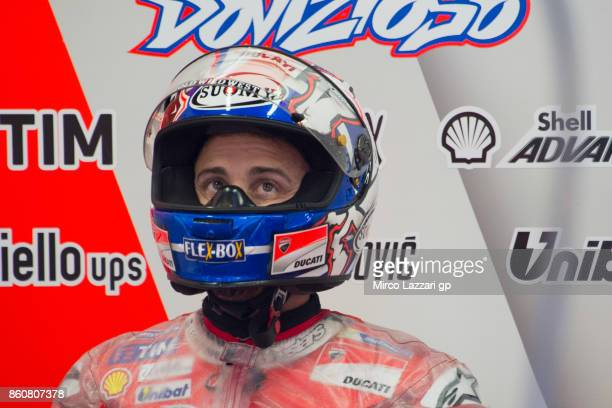 Andrea Dovizioso of Italy and Ducati Team looks on in box during the MotoGP of Japan Free Practice at Twin Ring Motegi on October 13 2017 in Motegi...