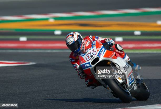 Andrea Dovizioso of Italy and Ducati Team rides during the warmup prior the Moto GP race at Circuit de Catalunya on June 11 2017 in Montmelo Spain