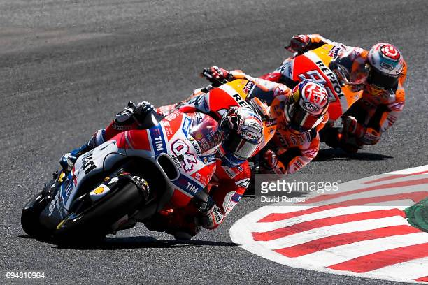 Andrea Dovizioso of Italy and Ducati Team rides to win ahead Marc Marquez of Spain and Repsol Honda Team and Dani Pedrosa of Spain and Repsol Honda...