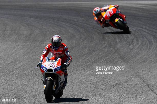 Andrea Dovizioso of Italy and Ducati Team rides to win ahead Marc Marquez of Spain and Repsol Honda Team during the MotoGp of Catalunya at Circuit de...