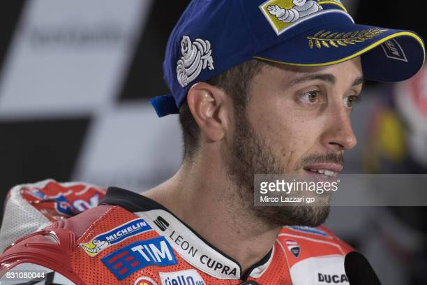 Andrea Dovizioso of Italy and Ducati Team smiles during the press conference at the end of the MotoGP race during the MotoGp of Austria Race at Red...