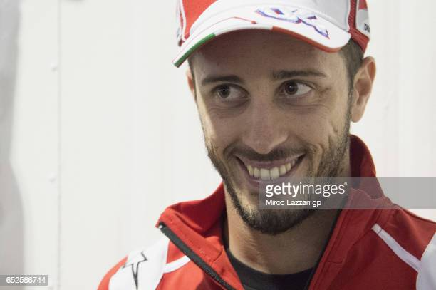 Andrea Dovizioso of Italy and Ducati Team smiles with journalists during the MotoGP Tests In Losail at Losail Circuit on March 12 2017 in Doha Qatar