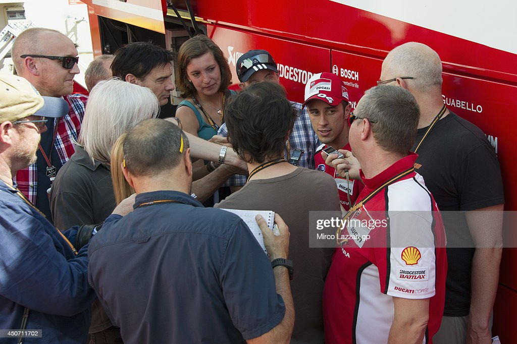 <a gi-track='captionPersonalityLinkClicked' href=/galleries/search?phrase=Andrea+Dovizioso&family=editorial&specificpeople=559970 ng-click='$event.stopPropagation()'>Andrea Dovizioso</a> of Italy and Ducati Team speaks with journalists at the end of the MotoGp Tests In Montmelo at Circuit de Catalunya on June 16, 2014 in Montmelo, Spain.