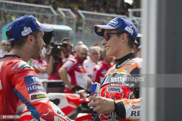 Andrea Dovizioso of Italy and Ducati Team speaks with Marc Marquez of Spain and Repsol Honda Team under the podium at the end of the MotoGP race...