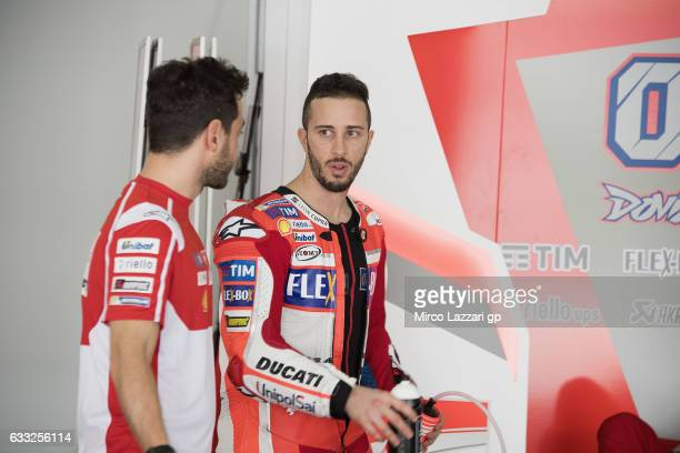 Andrea Dovizioso of Italy and Ducati Team speaks with mechanic n in box during the MotoGP Tests In Sepang at Sepang Circuit on February 1 2017 in...