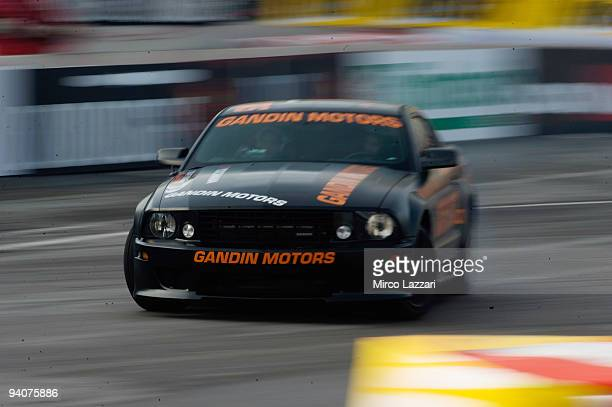 Andrea Dovizioso of Italy and Ford Mustang drives during the Yokohama Superbikers Drifting during the Motor Show 2009 on December 6 2009 in Bologna...