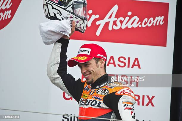Andrea Dovizioso of Italy and Repsol Honda Team celebrates the second place on the podium at the end of the MotoGP race of MotoGp Of Great Britain at...