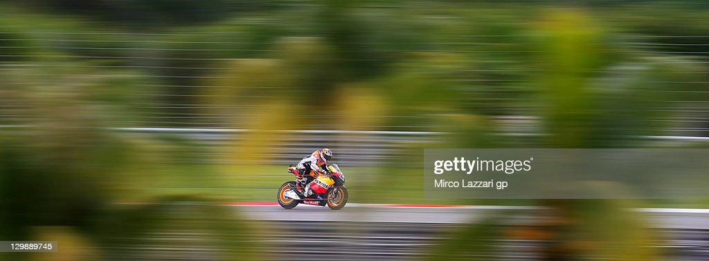 <a gi-track='captionPersonalityLinkClicked' href=/galleries/search?phrase=Andrea+Dovizioso&family=editorial&specificpeople=559970 ng-click='$event.stopPropagation()'>Andrea Dovizioso</a> of Italy and Repsol Honda Team heads down a straight during the free practice for the MotoGP of Malaysia at Sepang Circuit on October 21, 2011 in Kuala Lumpur, Malaysia.