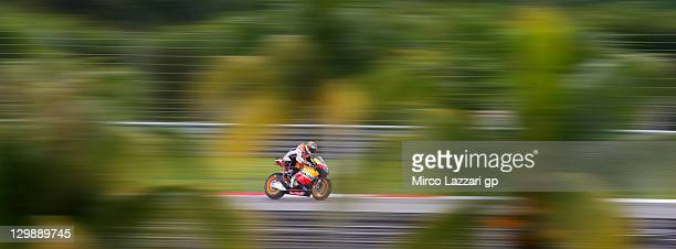 Andrea Dovizioso of Italy and Repsol Honda Team heads down a straight during the free practice for the MotoGP of Malaysia at Sepang Circuit on...