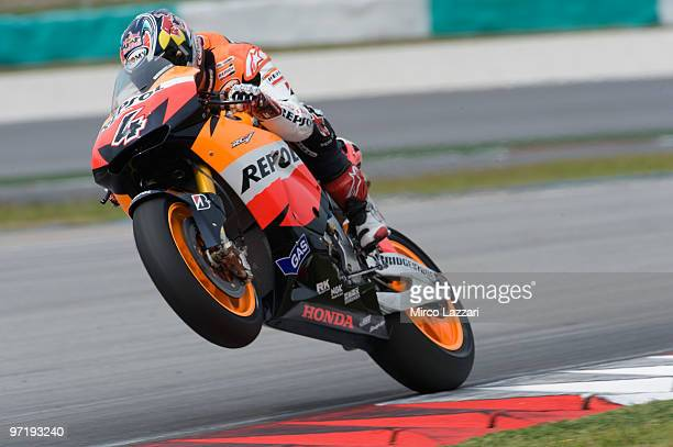 Andrea Dovizioso of Italy and Repsol Honda Team Lifts the front wheel during the day of testing at Sepang Circuit on February 26 2010 in Kuala Lumpur...