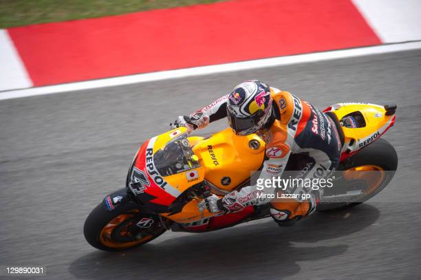 Andrea Dovizioso of Italy and Repsol Honda Team rounds the bend during the free practice for the MotoGP of Malaysia at Sepang Circuit on October 21...