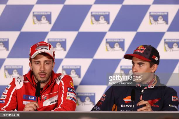 Andrea Dovizioso of Italy and rider of the Ducati Team Ducati speaks to the media as Marc Marquez of Spain and rider of the REPSOL HONDA TEAM Honda...