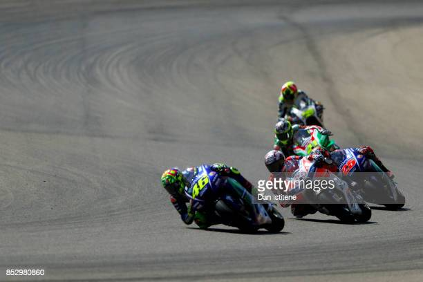 Andrea Dovizioso of Italy and the Ducati Team and Maverick Vinales of Spain and Movistar Yamaha MotoGP ride behind Valentino Rossi of Italy and...