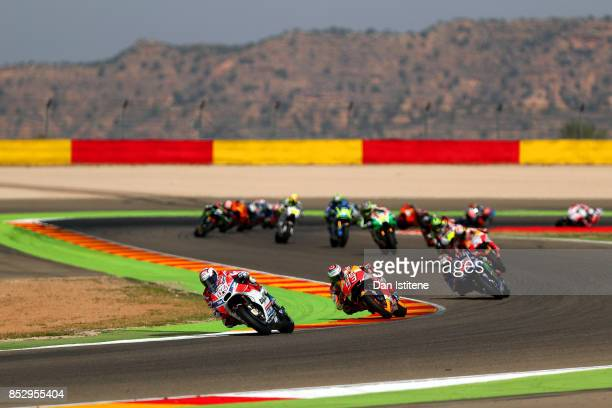 Andrea Dovizioso of Italy and the Ducati Team rides ahead of Marc Marquez of Spain and the Repsol Honda Team during the MotoGP of Aragon at Motorland...