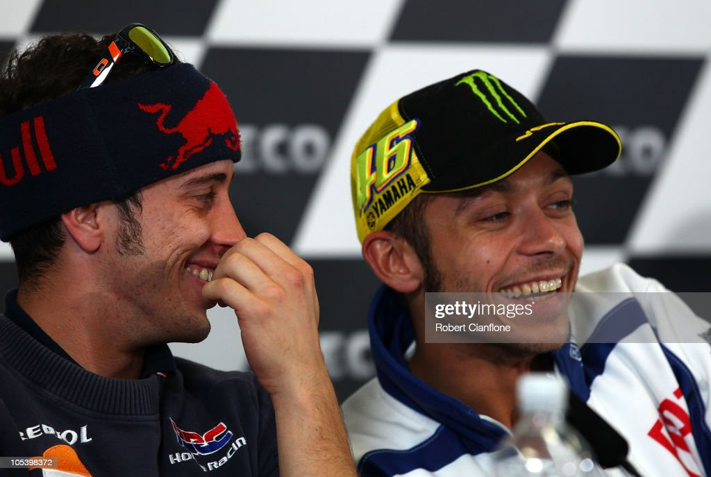 <a gi-track='captionPersonalityLinkClicked' href=/galleries/search?phrase=Andrea+Dovizioso&family=editorial&specificpeople=559970 ng-click='$event.stopPropagation()'>Andrea Dovizioso</a> of Italy and the Repsol Honda Team laughs with <a gi-track='captionPersonalityLinkClicked' href=/galleries/search?phrase=Valentino+Rossi&family=editorial&specificpeople=157603 ng-click='$event.stopPropagation()'>Valentino Rossi</a> of Italy and the Fiat Yamaha Team during a press conference prior to the Australian MotoGP, which is round 16 of the MotoGP World Championship, at Phillip Island Grand Prix Circuit on October 14, 2010 in Phillip Island, Australia.
