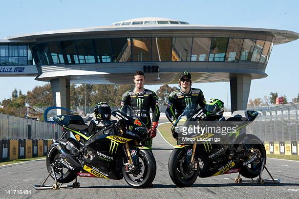 Andrea Dovizioso of Italy and Yamaha Tech 3 and Cal Crutchlow of Great Britain and Monster Yamaha Tech 3 pose with the bikes on track during the...