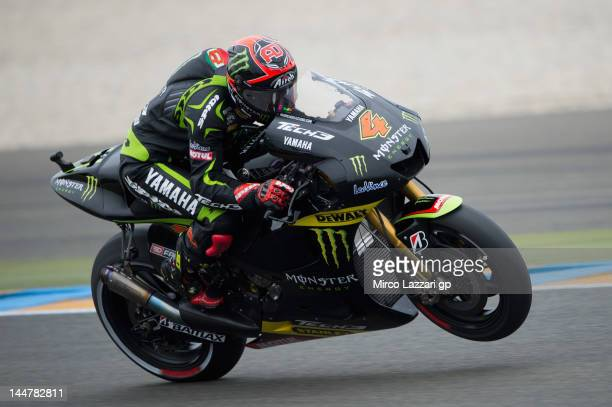 Andrea Dovizioso of Italy and Yamaha Tech 3 lifts the front wheel during the qualifying practice of the MotoGp Of France on May 19 2012 in Le Mans...
