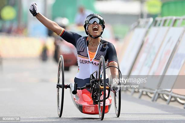 Andrea Eskau of Germany celebrates winning the gold medal in the Women's Road H5 on day 8 of the Rio 2016 Paralympic Games at Pontal on September 15...