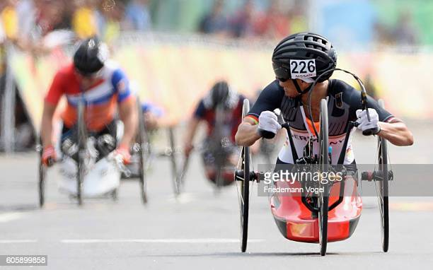 Andrea Eskau of Germany crosses the finish line to win the gold medal in the Women's Road H5 on day 8 of the Rio 2016 Paralympic Games at Pontal on...