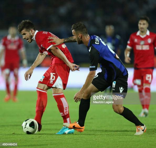 Andrea Esposito of Latina competes for the ball with Joao Silva of Bari during the Serie B playoff match between US Latina and AS Bari at Stadio...