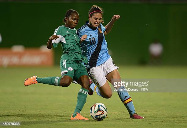 Andrea Falcon of Spain battles with Esther Elijah of Nigeria during the FIFA U17 Women's World Cup Quarter Final match between Nigeria and Spain at...