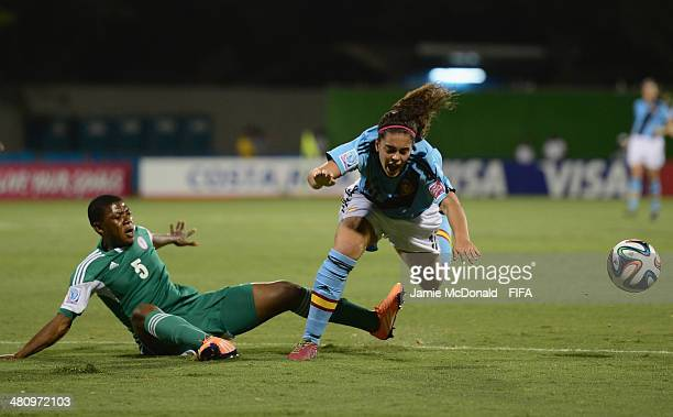 Andrea Falcon of Spain is awarded a penalty from the challenge of Ugochi Emenayo of Nigeria during the FIFA U17 Women's World Cup Quarter Final match...