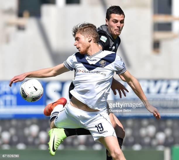 Andrea Favilli of Ascoli Picchio 1898 FC and Filippo Romagna of Brescia Calcio in action during the Serie B match between Ascoli Picchio 1898 FC and...