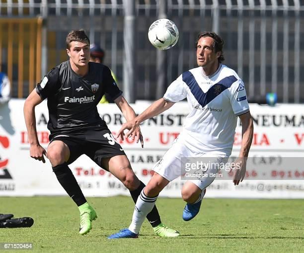 Andrea Favilli of Ascoli Picchio 1898 FC and Stefano Mauri of Brescia Calcio in action during the Serie B match between Ascoli Picchio 1898 FC and...