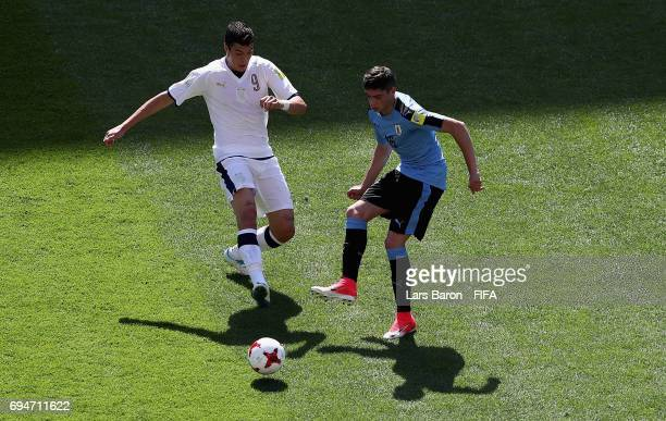 Andrea Favilli of Italy challenges Federico Valverde of Uruguay during the FIFA U20 World Cup Korea Republic 2017 3rd rank playoff match between...
