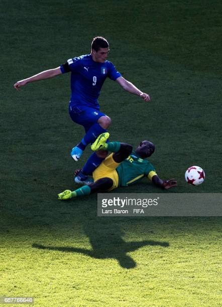 Andrea Favilli of Italy is challenged by Repo Malepe of South Africa during the FIFA U20 World Cup Korea Republic 2017 group D match between South...
