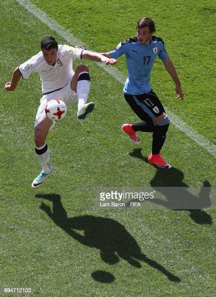 Andrea Favilli of Italy is challenges by Matias Vina of Uruguay during the FIFA U20 World Cup Korea Republic 2017 3rd rank playoff match between...