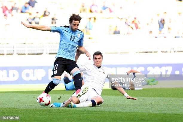 Andrea Favilli of Italy slide tackles Matias Vina of Uruguay during the FIFA U20 World Cup Korea Republic 2017 3rd rank playoff match at Suwon World...