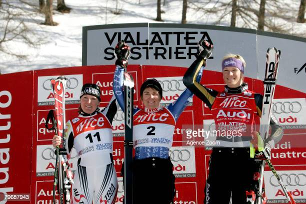 Andrea Fischbacher of Austria and Fabienne Suter of Switzerland tie for first place and Maria Riesch of Germany who took third place celebrate on the...