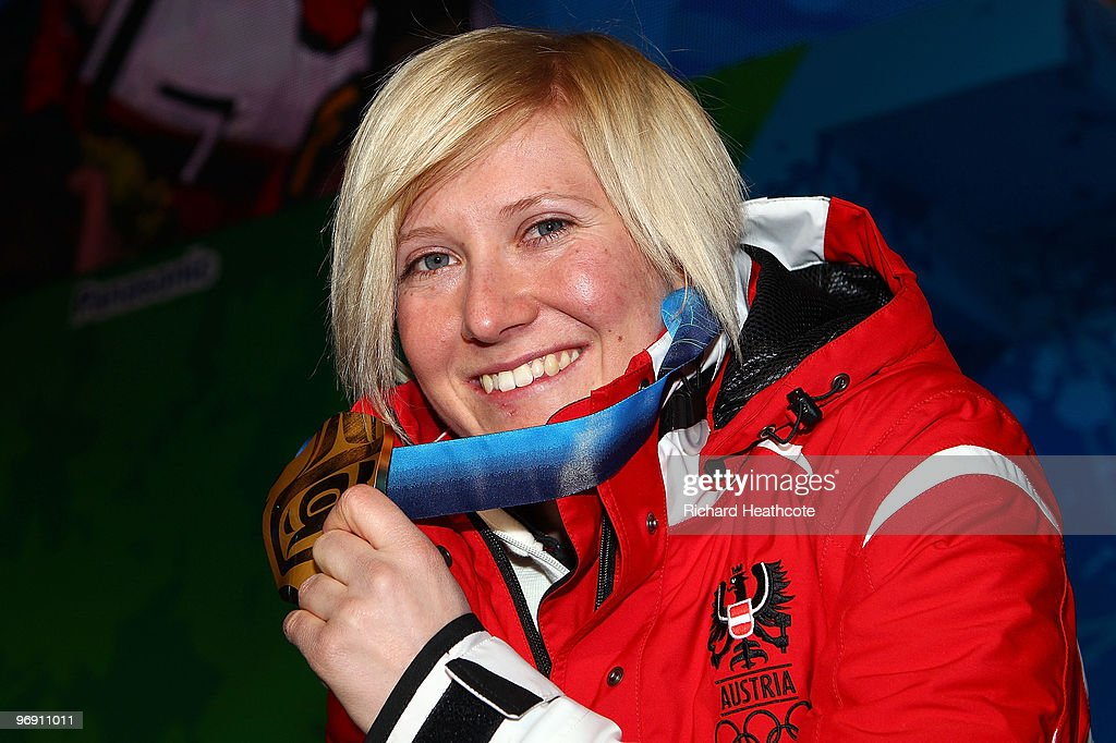 <a gi-track='captionPersonalityLinkClicked' href=/galleries/search?phrase=Andrea+Fischbacher&family=editorial&specificpeople=800274 ng-click='$event.stopPropagation()'>Andrea Fischbacher</a> of Austria receives the gold medal during the medal ceremony for the women's super-g alpine skiing held at the Whistler Medals Plaza on day 9 of the Vancouver 2010 Winter Olympics at Whistler Medals Plaza on February 20, 2010 in Whistler, Canada.
