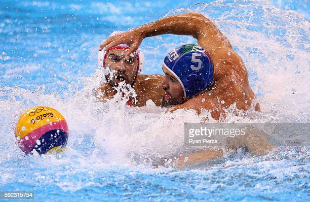 Andrea Fondelli of Italy competes for the ball against Vjekoslav Paskovic of Montenegro during the Men's Water Polo Bronze Medal match between the...