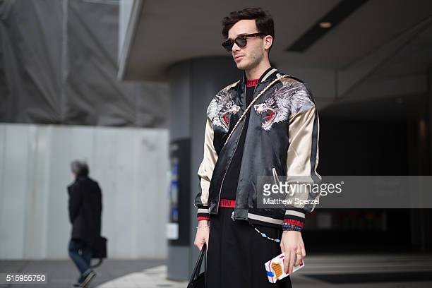 Andrea Frugani attends the Anne Sofie Madsen show during Tokyo Fashion Week wearing Moschino sweater and bag Lad Musician skirt Zara pants Celine bag...